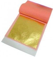 Золото в листах для украшения кондитерских или кулинарных изделий.